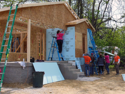 Volunteers raise the roof at the Pope Francis House.