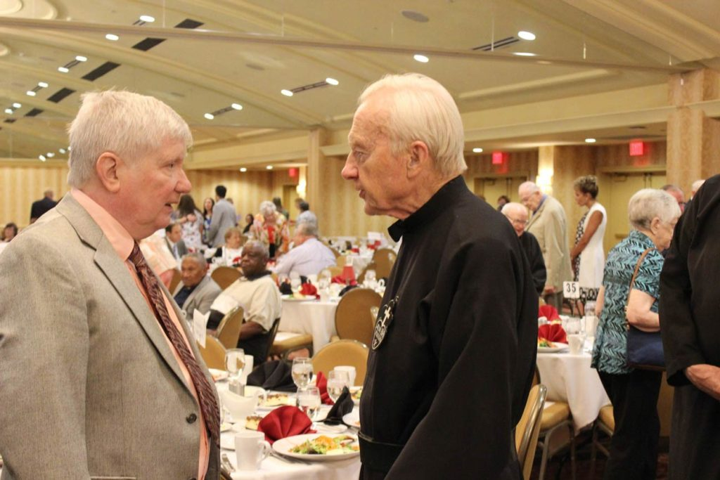 Terry McDevitt and Fr. Sebastian MacDonald before the luncheon began.