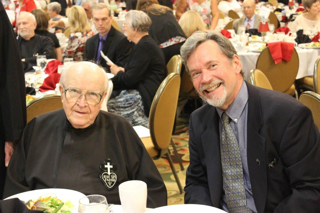 Fr. Ron Corl, CP, and Phil Jackson.