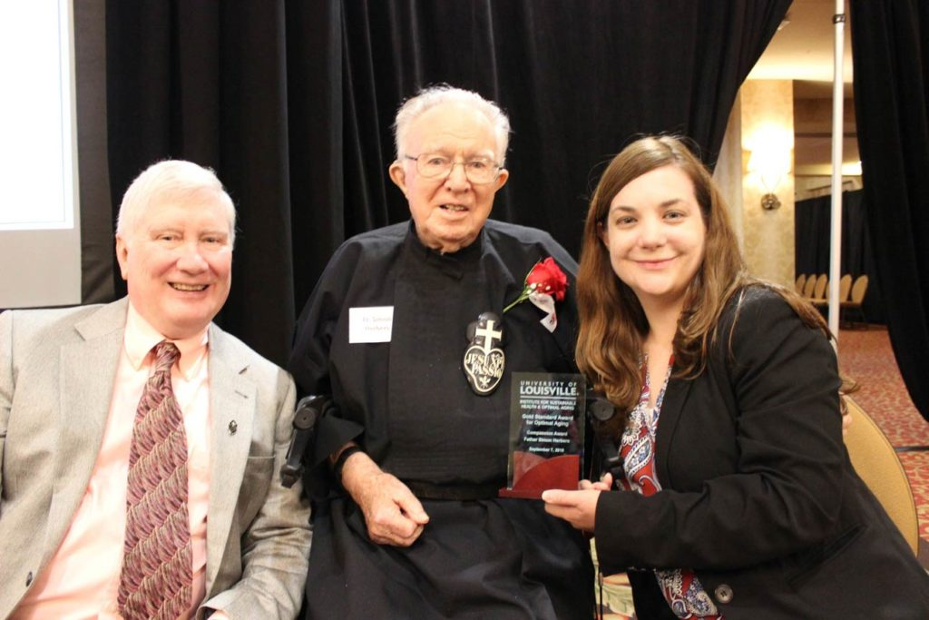 Dr. Terry McDevitt, Fr. Simon Herbers, CP, and Michelle Rudovich.
