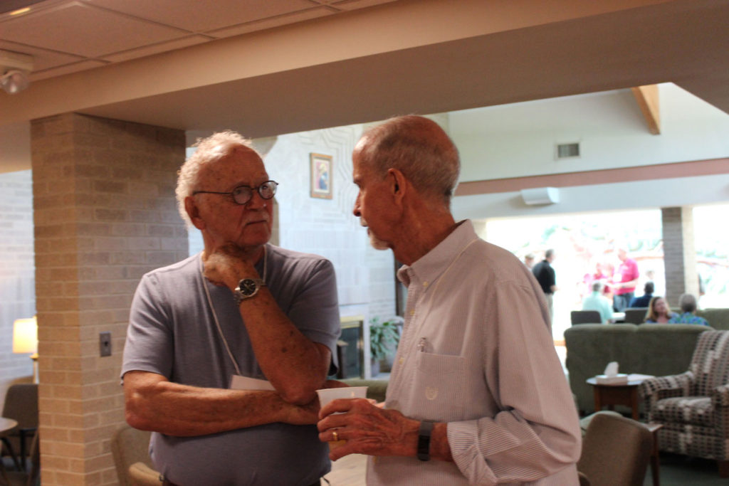 Pat Hanson and Don Noltemeyer share a conversation.