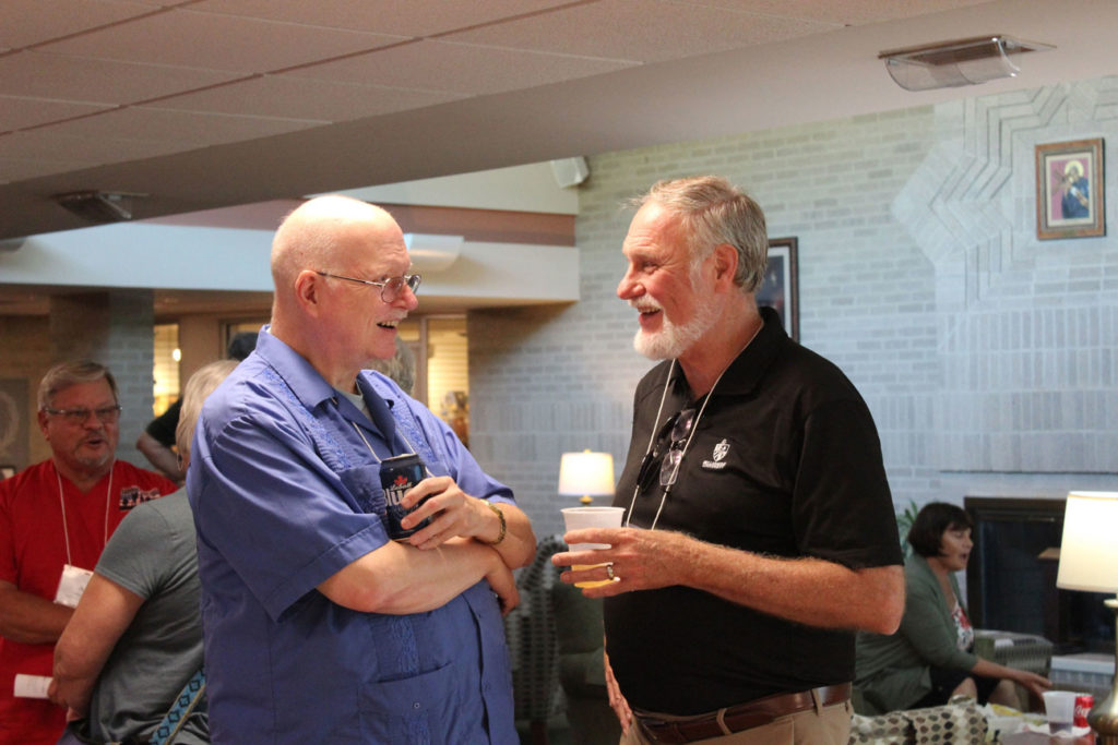 Fr. Phil Paxton, CP, and Paul Schulte share a laugh.