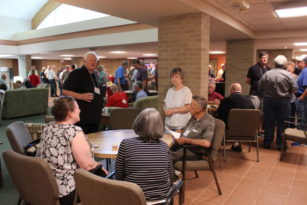 Fr. Bob Weiss, CP, Valerie and Frank Mullally chat with Tammy Drean and Susan Noltemeyer (backs to camera).