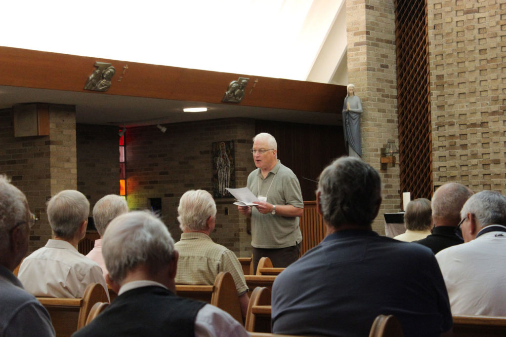 Paul Wadell proclaimed the Scripture reading during the prayer service.