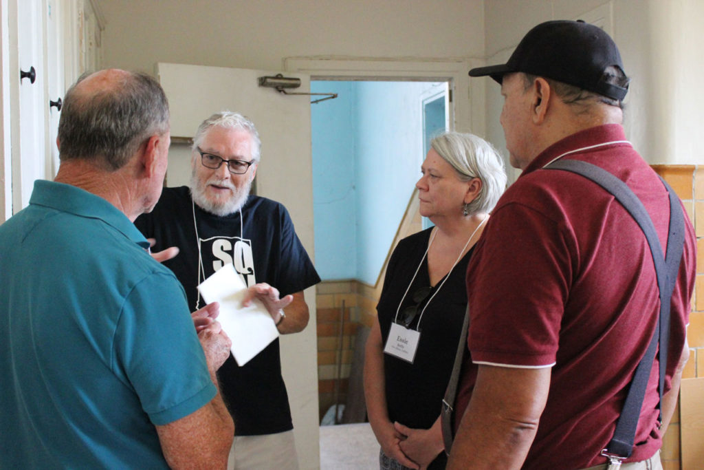 Denny and Essie Reilly reminisce with Rich Padilla and Charlie Phillips in the old kitchen area.