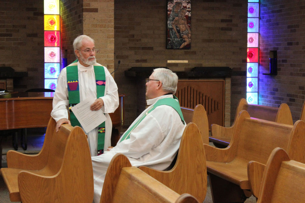 Fr. Bob Knight and Fr. Richard Crager, SDB, chat before Mass.
