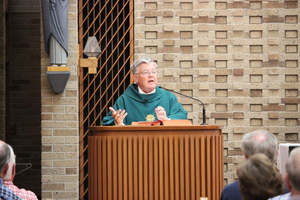 Fr. John Schork, CP, proclaimed the Gospel.