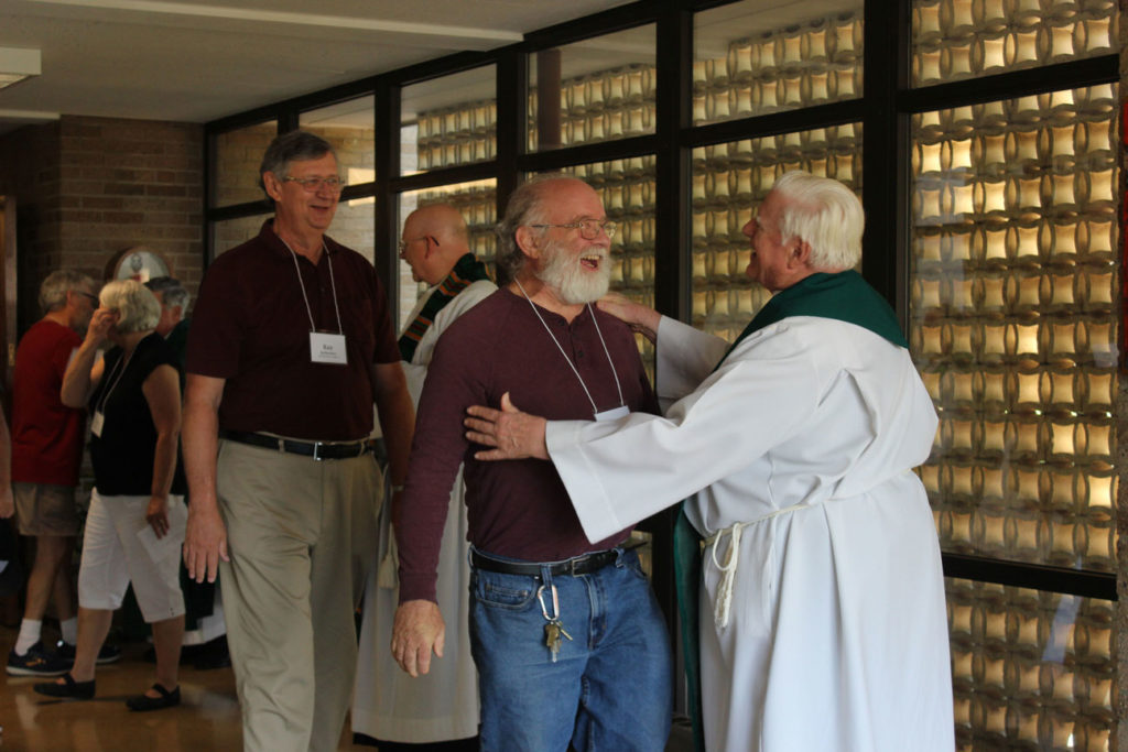Paul Della Mora shares a laugh with Fr. Bob Weiss, CP, after Mass.