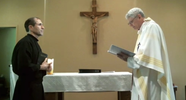 Fr. Joe Moons begins the profession rite by asking Nicholas for his intention.