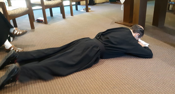 The Rite of Profession calls for Nicholas to lie prostrate as the Gospel of the Passion is read.