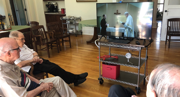 The Passionist Community at Sacred Heart Monastery in Louisville, Kentucky, followed the profession rite via live-streaming.